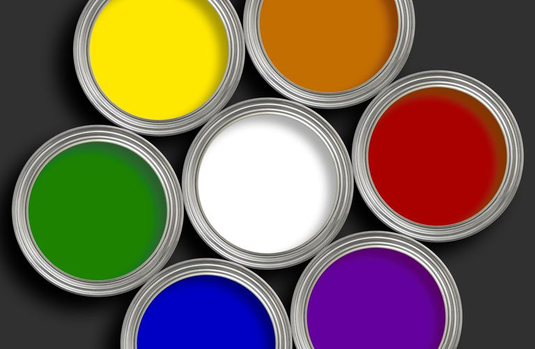 viewing 7 open paint cans from the top, in a circle, white in the middle surrounded by yellow, orange, red, purple, blue, and green