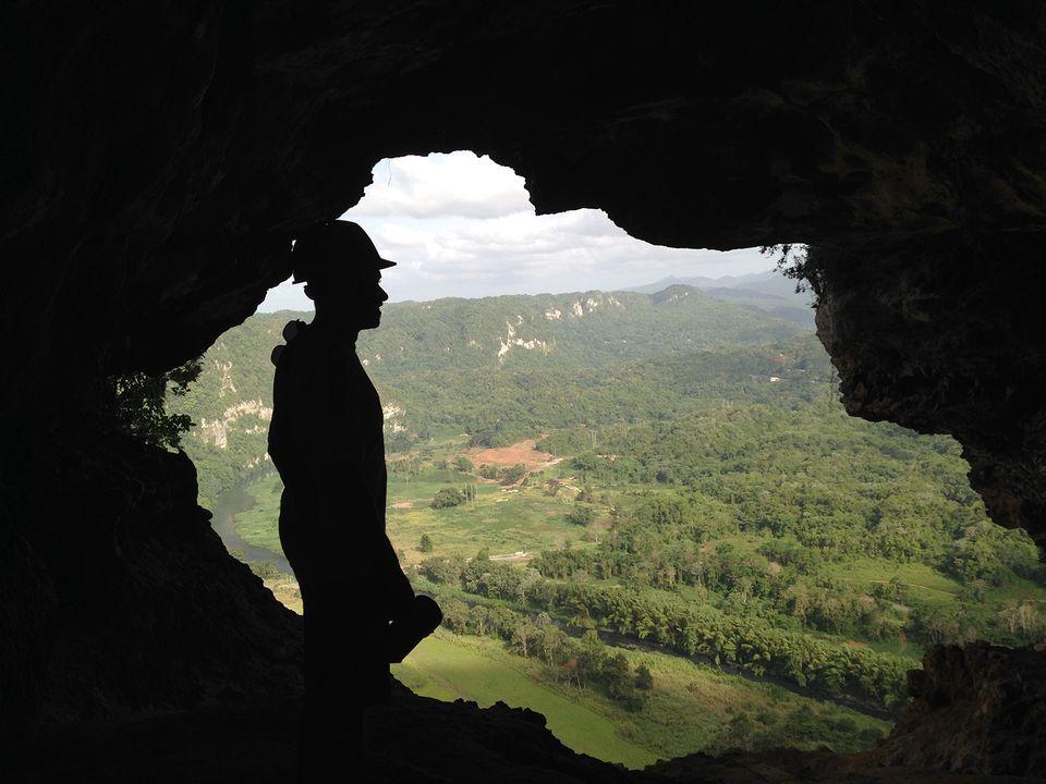 Silhouette Man Standing In Cueva Ventana Against Landscape.