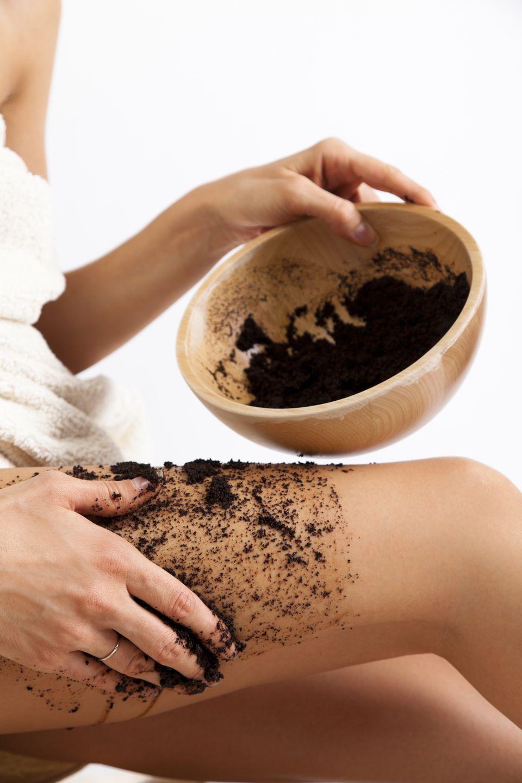 Natural body care. Cellulite massage with coffee scrub