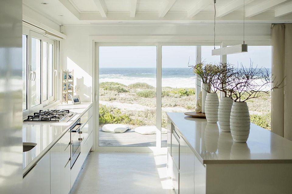 Modern white kitchen with ocean view