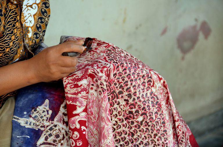 woman dying batik with batik wax