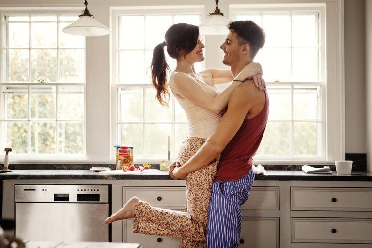 Couple flirting while making breakfast