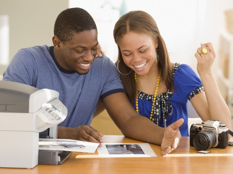 African couple printing out photographs