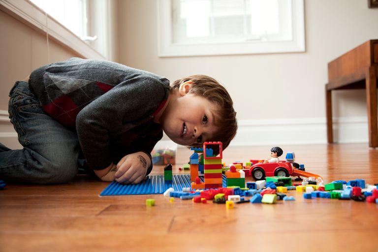 Boy looking at plastic blocks