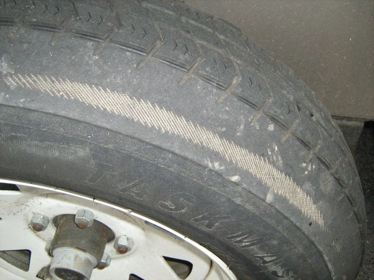 A tire with significant wear damage