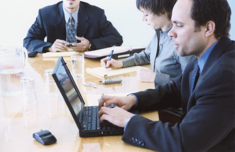 Man takes meeting minutes on a laptop