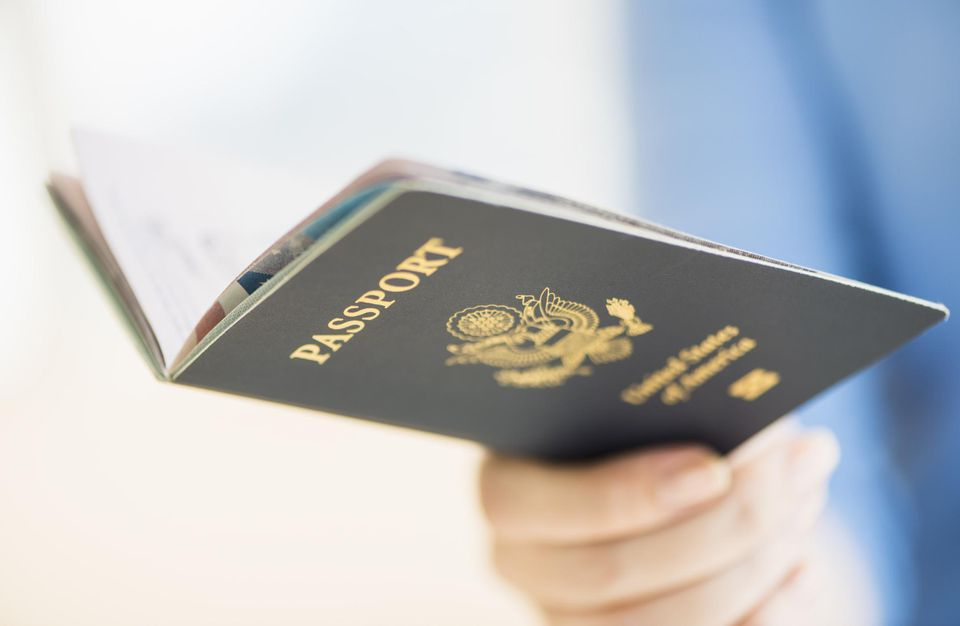 New Jersey, Jersey City, Close up of woman's hand holding open passport
