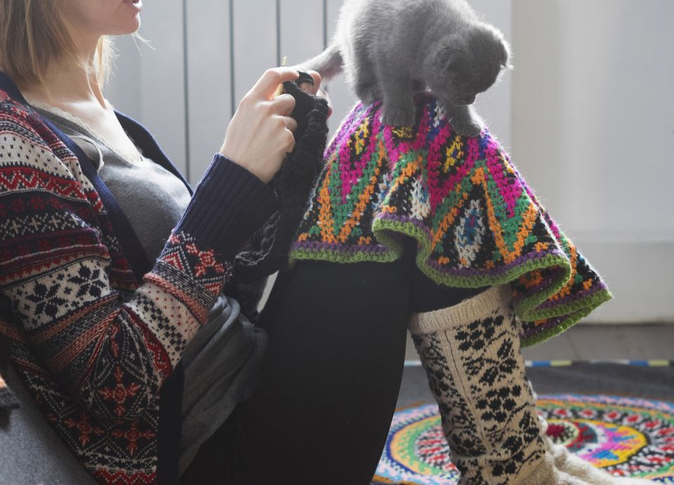 Woman Crocheting with Blanket and Cat