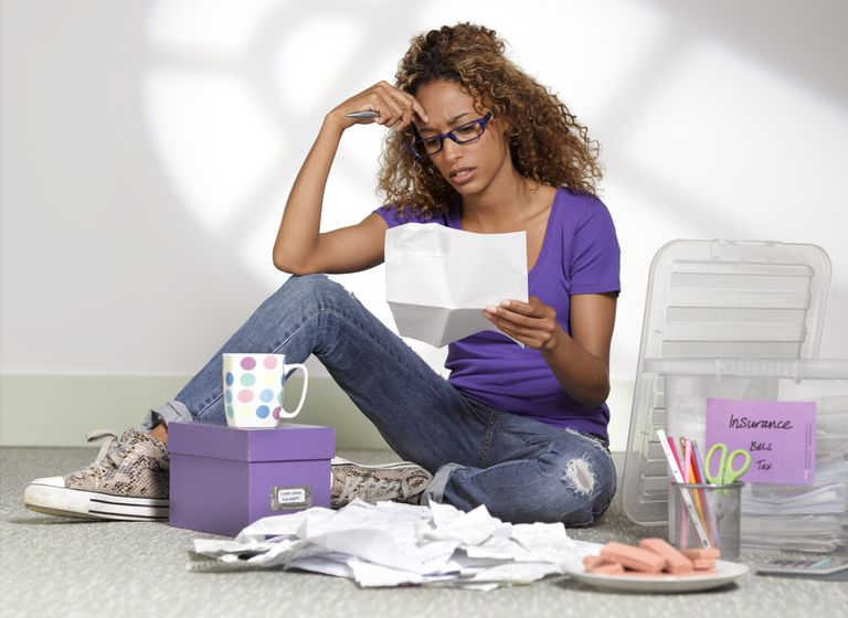 Young businesswoman with paperwork