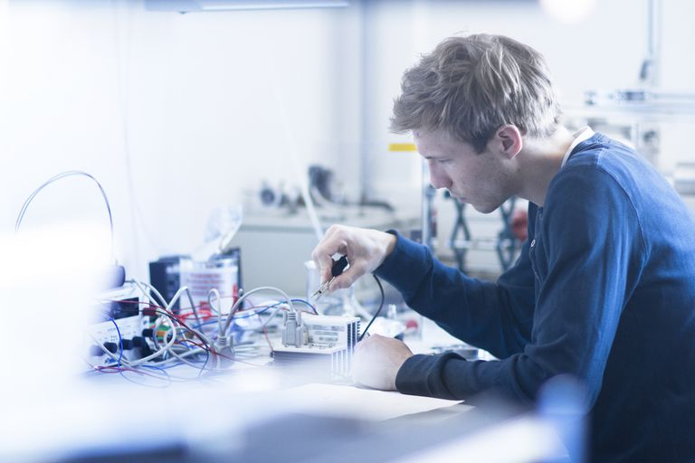 Technician constructing electric component part