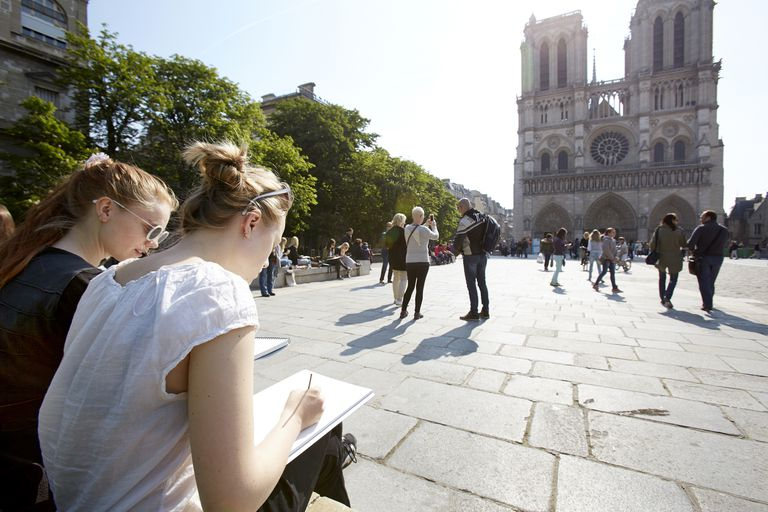 Young artists sketching at Notre Dame