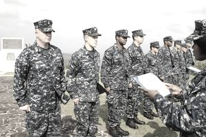IWO TO (March 12, 2012) Lt. j.g. Pamela Pettis reads Sailors assigned to the forward-deployed amphibious dock landing ship USS Germantown (LSD 42) their honorable discharge certificates during a reenlistment ceremony held atop Mt. Suribachi on the island of Iwo To, formally known as Iwo Jima.
