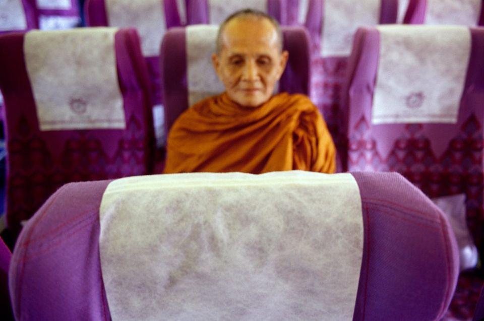 Burmese monk on domestic flight in Myanmar.