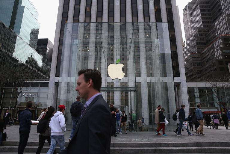 NEW YORK, NY - APRIL 22: People walk past Apple's Fifth Avenue store on Earth Day in Midtown Manhattan on April 22, 2014 in New York City. The store is one of at least 120 Apple stores currently.