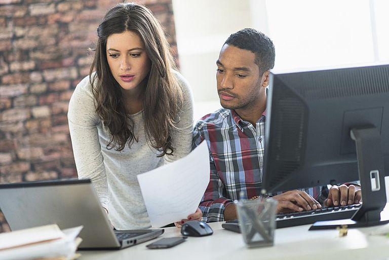 Small nonprofit staff filing tax form.