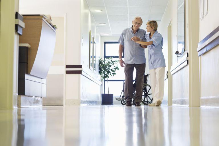 Nurse Helping Man Walk