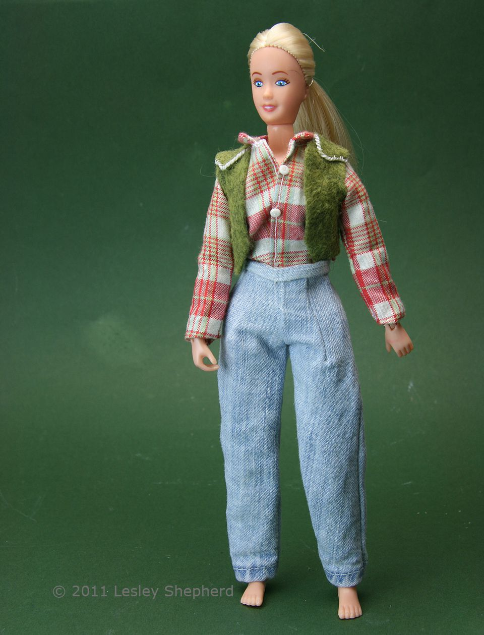 Custom fitted removable doll jeans on a Brenda Breyer model horse rider doll.