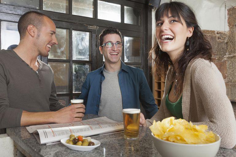 Friends talking in tapas bar