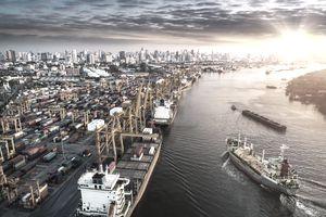 ships at a busy import/export hub