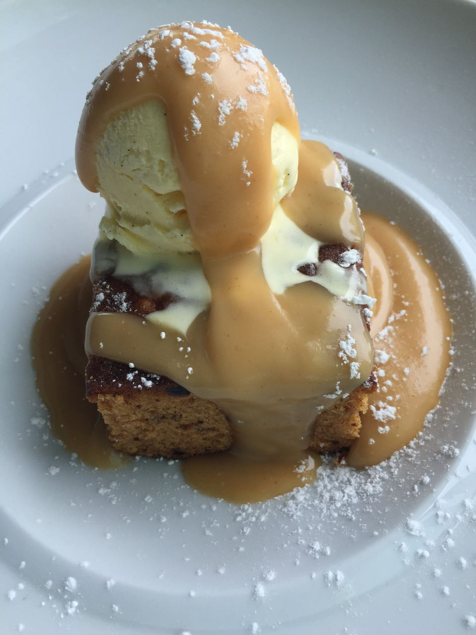 dessert sauce over cake and ice cream