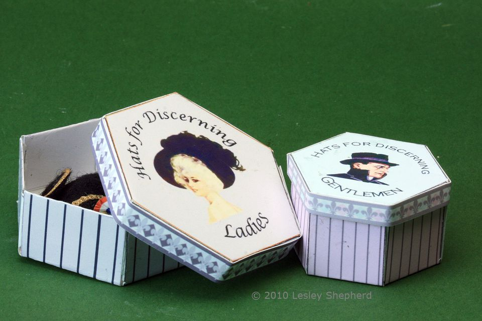Miniature printable hexagonal hat boxes for brimmed and regular hats in dolls house scales.