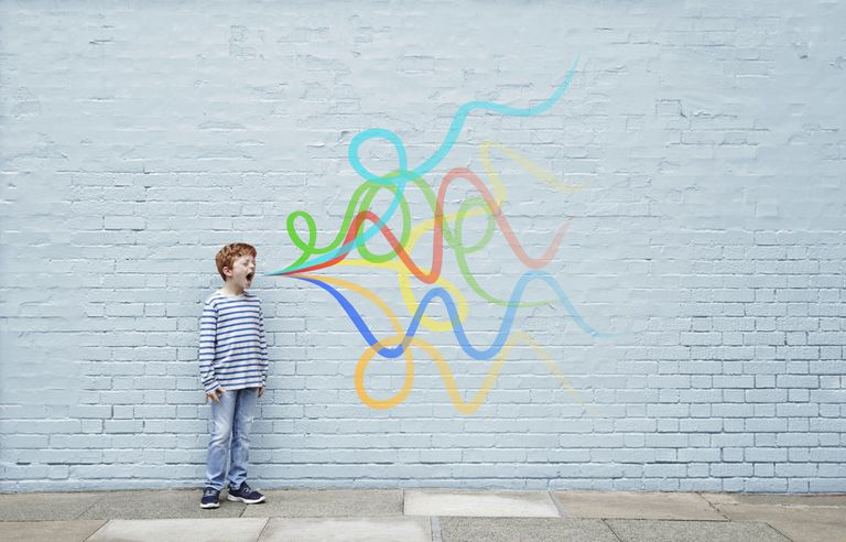 Little boy shouting with colorful sound waves