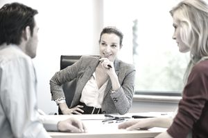 Businesswoman discussing with her clients
