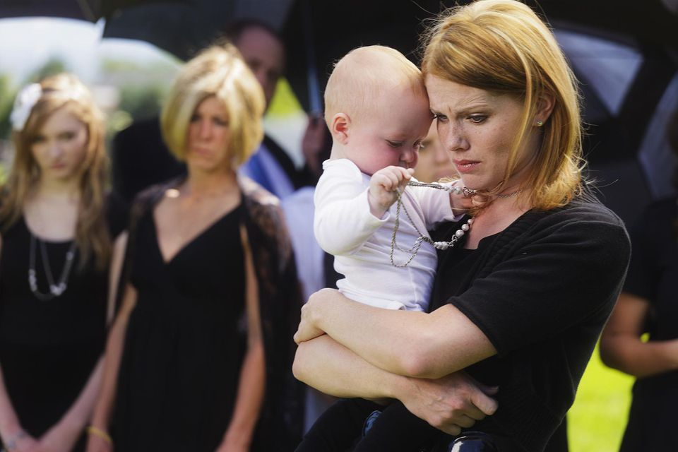 Mother and Baby at a Funeral