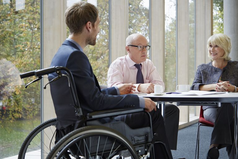 Disabled man in wheelchair.
