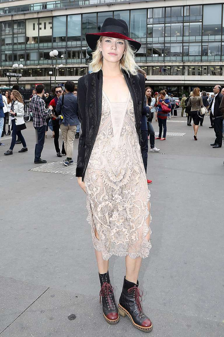 Elena Perminova, wearing a dress and combat boots, attends the Elie Saab show during Paris Fashion Week.