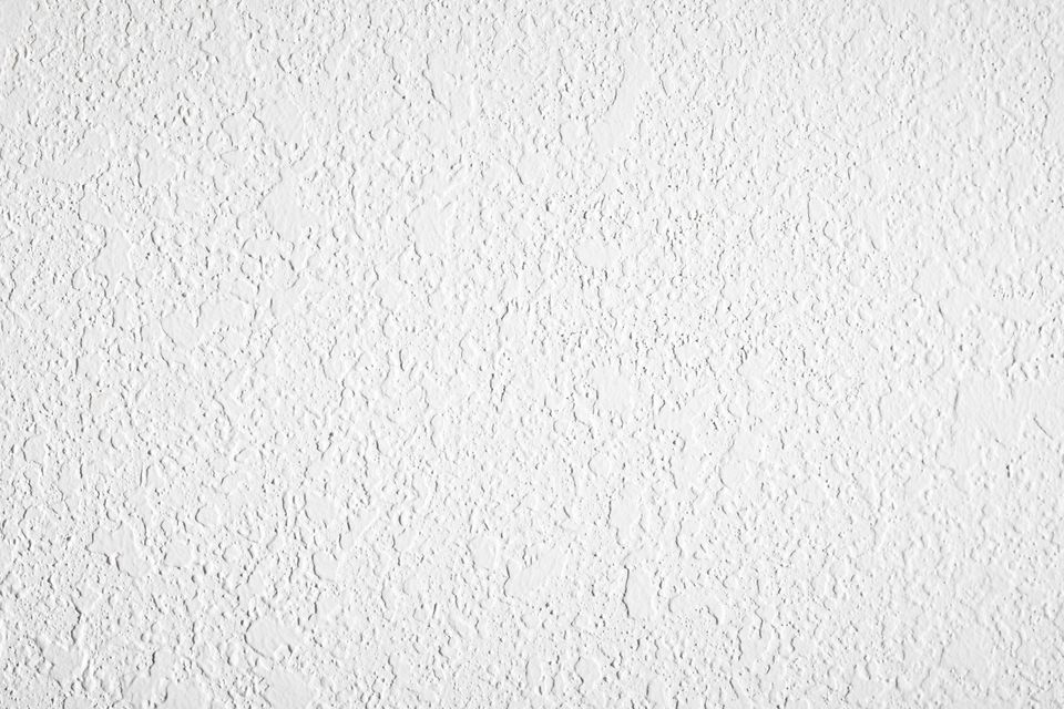 high contrast textured white plaster wall