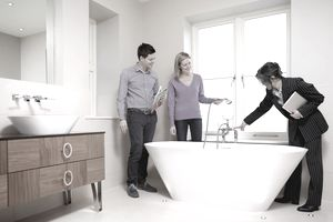 Real estate agent showing of bath
