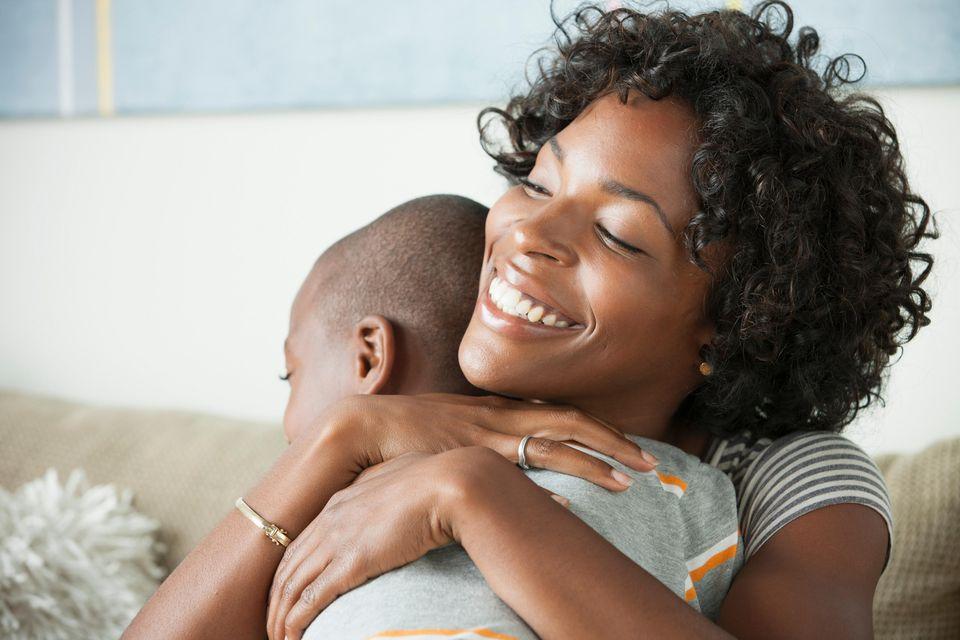 Portrait of mother hugging son