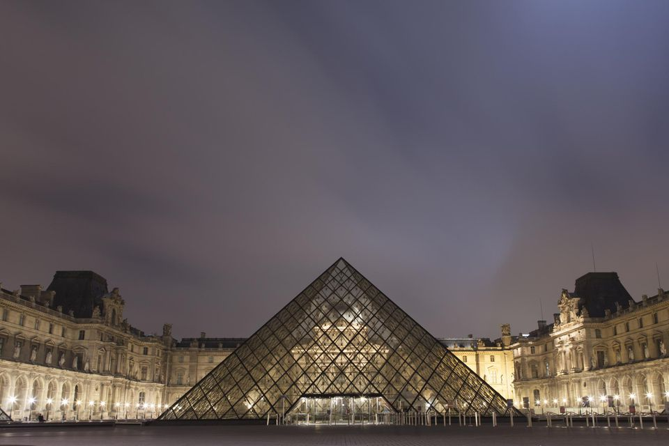 The Louvre Museum at night in Paris