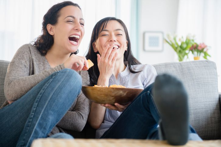 Female friends enjoying a movie.