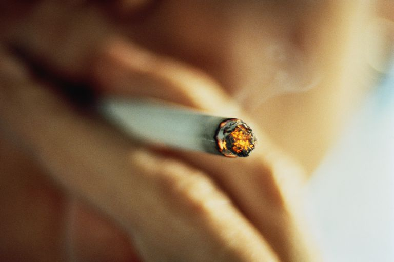 Person smoking cigarette, close-up