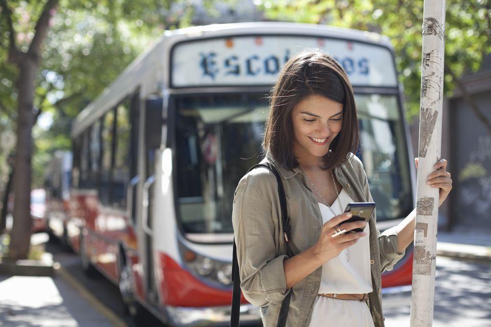 Woman on phone near bus