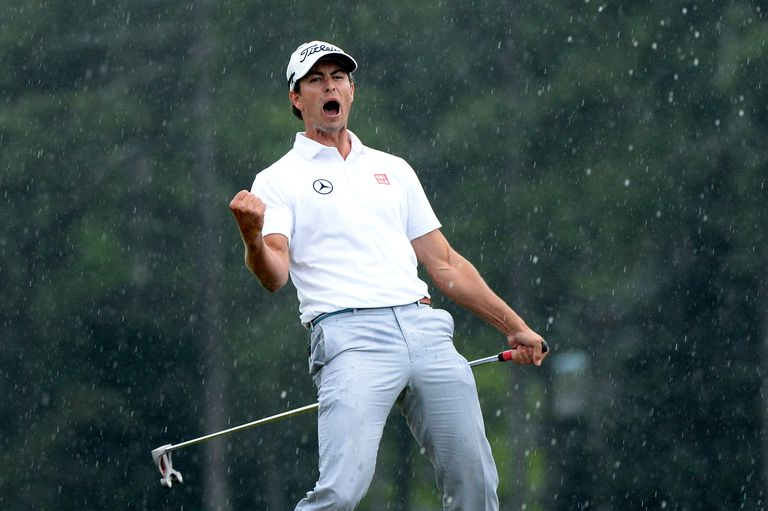 Adam Scott celebrates after making a birdie on the 18th hole during the final round of the 2013 Masters