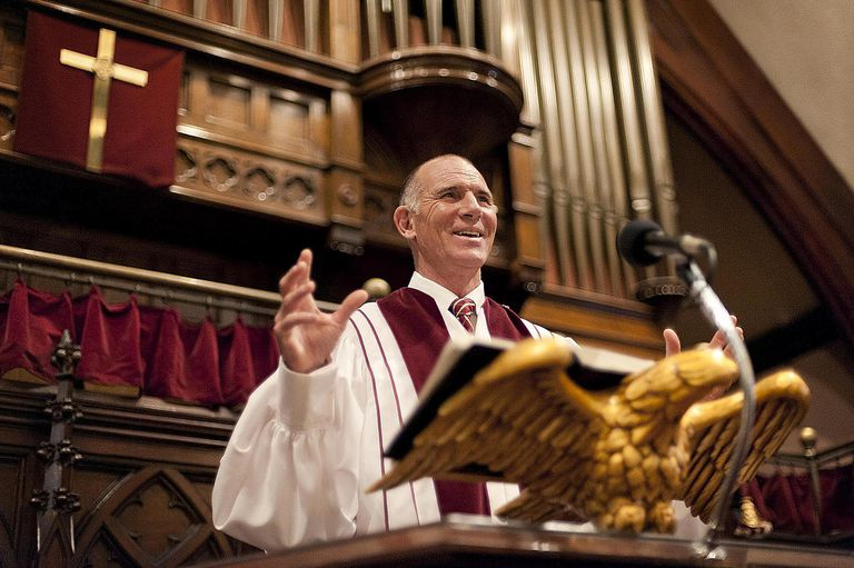 Preacher Delivering Speech During Service.