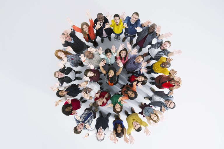 Portrait of enthusiastic business people in circle