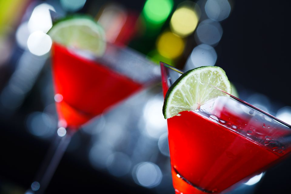 red martini with lime garnish