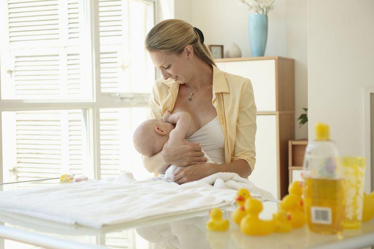 Mother Nursing Infant Son