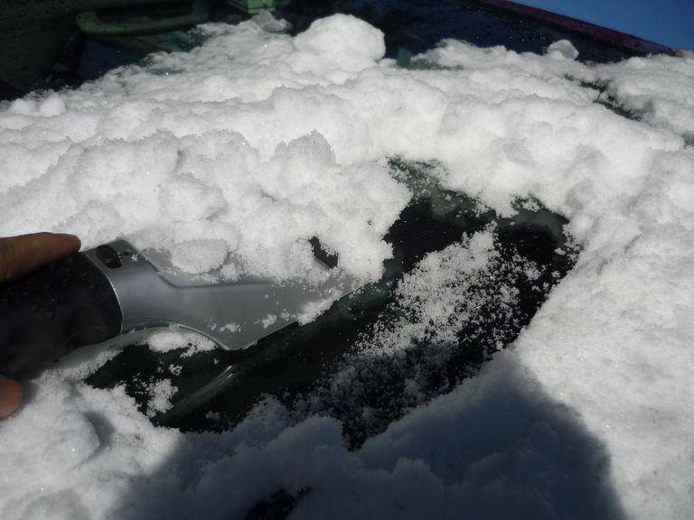 ice scraper on snow