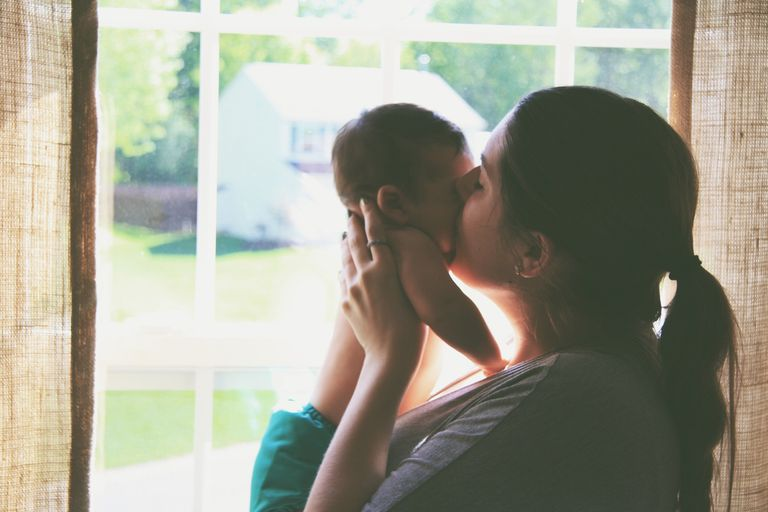 Side View Of Mother And Baby At Home