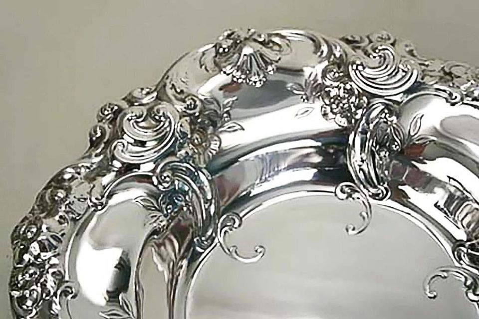 """Detail of sterling silver """"Melrose"""" pattern bowl by Gorham Manufacturing Company."""