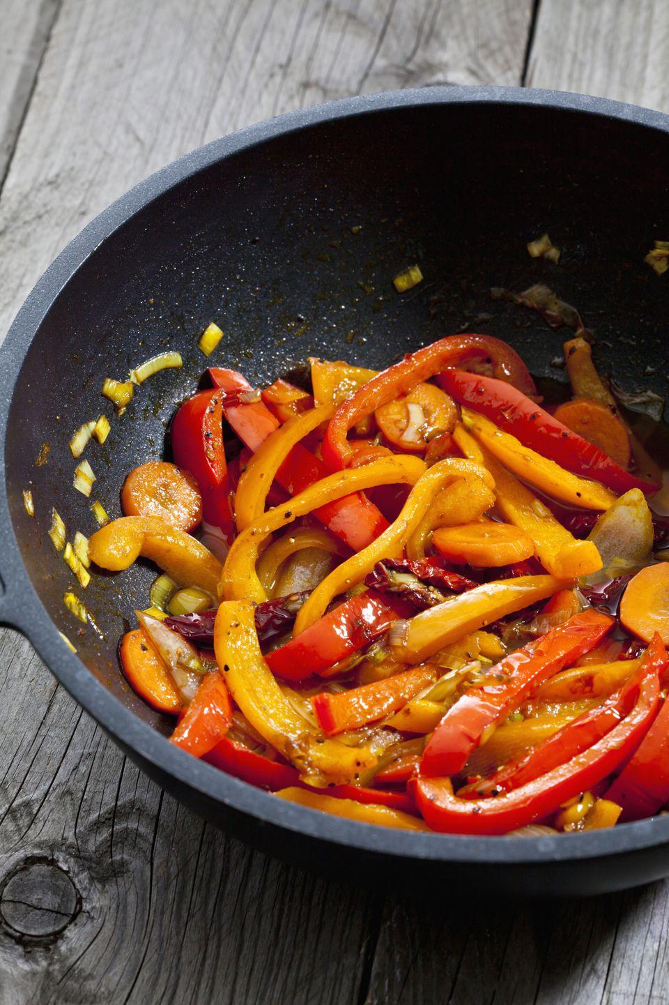 Cooking up some vegetarian bell pepper fajitas!