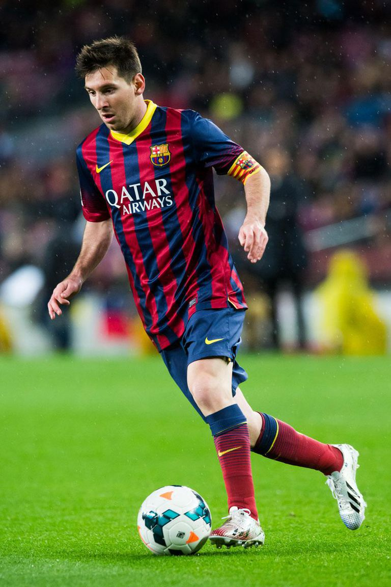 BARCELONA, SPAIN - MARCH 26: Lionel Messi of FC Barcelona runs with the ball during the La Liga match between FC Barcelona and RC Celta de Vigo at Camp Nou on March 26, 2014 in Barcelona, Spain.