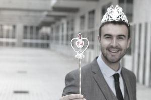 businessman wearing tiara and magic wand