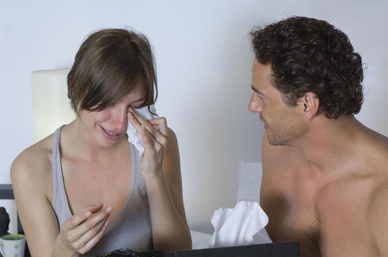 Man comforting a crying woman