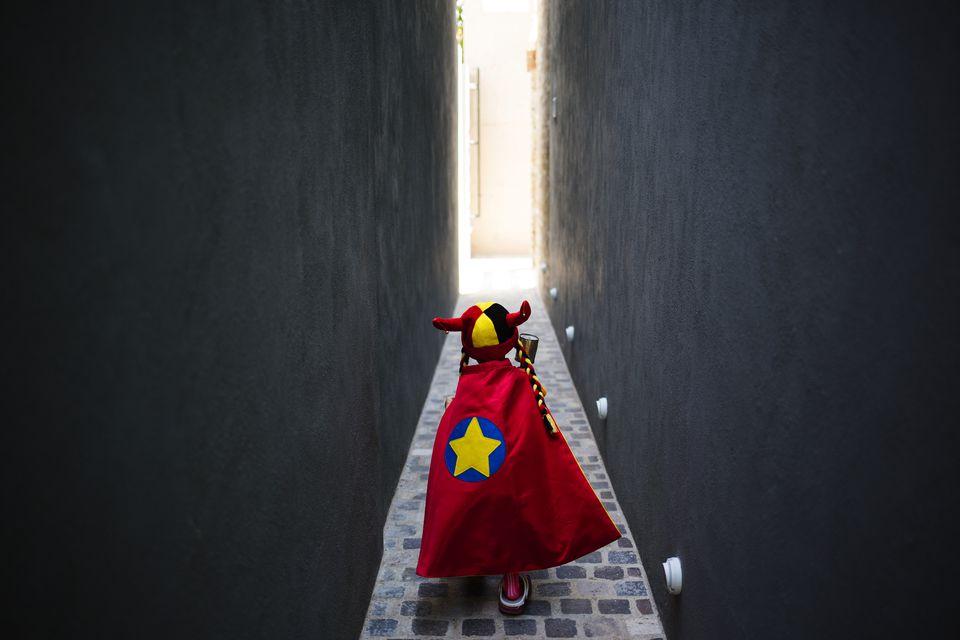 Caucasian girl wearing superhero costume